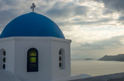 Blue dome of white church and  clouds, Oia, Santorini, Greece Stock Photo
