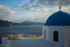Blue dome of white church and  clouds, Oia, Santorini, Greece Royalty Free Stock Photos