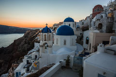 Blue dome of white church in Oia, Santorini, Greece. Image of Blue dome of white church in Oia, Santorini, Greece Royalty Free Stock Images