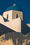 Blue dome of a white church at sunset, Oia village, Santorini island Stock Photography