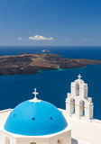Blue-domed chapel with ochre bell tower in Oia Stock Photography