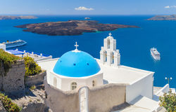 Blue-domed chapel with ochre bell tower in Oia Royalty Free Stock Image