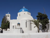 Blue domed church in Santorini, Greece Royalty Free Stock Image