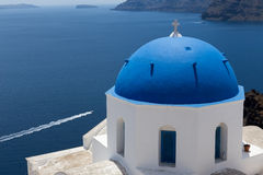 Blue domed churches on the Caldera at Oia on the Greek Island of Royalty Free Stock Photography