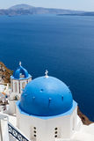 Blue domed churches on the Caldera at Oia on the Greek Island of Royalty Free Stock Photo