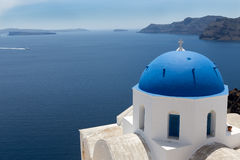 Blue domed churches on the Caldera at Oia on the Greek Island of Royalty Free Stock Photos