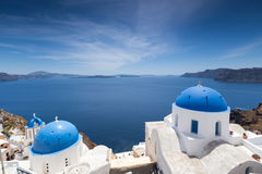Blue domed churches on the Caldera at Oia on the Greek Island of Stock Photo