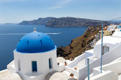 Blue domed churches on the Caldera at Oia on the Greek Island of Stock Images