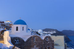 Blue domed churches on the Caldera at Oia on the Greek Island of Stock Photography