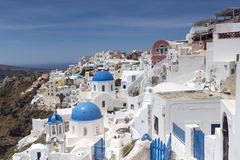 Blue domed churches on the Caldera at Oia on the Greek Island of Royalty Free Stock Image