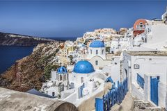 Blue domed churches in the village of Oia, Santorini Thira, Cyclades Islands, Aegean Sea Royalty Free Stock Image