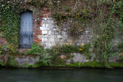 Blue Door. With railing above the river Itchen in Winchester stock photo