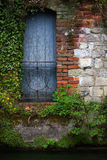 Blue door. Garden door painted blue with railing and brickwork on the river itchen Stock Photos