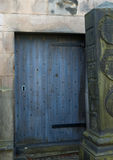 Blue door. On an old graveyard in Edinburgh, Scotland Royalty Free Stock Photography