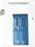 Blue Door. A blue door on a white wall, island of Sifnos,Greece stock photos