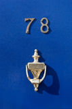 Blue door. With a handle Stock Photos