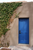 The Blue Door. This blue door is part of an adobe style building in Santa Fe, New Mexico Stock Photography