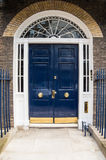 Blue Door. A Blue door with arched glass pannels Royalty Free Stock Photos