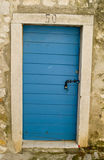 Blue door. In Rovinj on an old house Royalty Free Stock Image