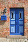 Blue door. Light blue and dark blue painted wooden door with stained glass windows royalty free stock photography