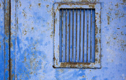 Blue door. Iron gate with blue grid Royalty Free Stock Photos