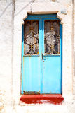 Blue door in antique village santorin   white wall Royalty Free Stock Image