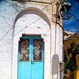 Blue door in antique village santorini greece europe and    whit Royalty Free Stock Images