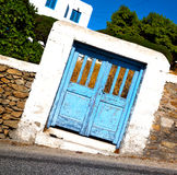 Blue door in antique village santorini greece europe and    whit Royalty Free Stock Image