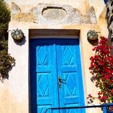 Blue door in antique village santorini greece europe and    whit Stock Photography