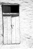 Blue door in antique village santorini greece europe and white w Royalty Free Stock Image