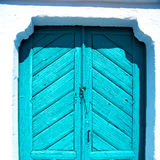 Blue door in antique village santorini greece europe and white wall Stock Photography