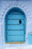 Blue door in a blue wall Royalty Free Stock Images