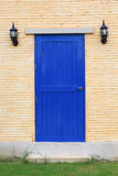 Blue door on the brick wall Royalty Free Stock Photo