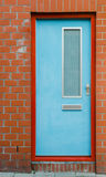 Blue Door on Brick Wall Royalty Free Stock Image