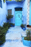 Blue door in Chefchaouen Royalty Free Stock Photos