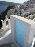 Blue door and city. Blue door on the island of Santorini Greece Royalty Free Stock Photos