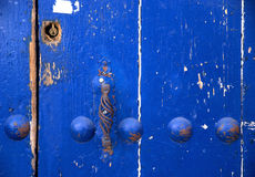 Blue door. Close up from an old weathered blue door. The photo was taken in Seville in August 2014 royalty free stock image