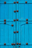 Blue door. Closed woodem blue gate to a building in Peru, Sacred Valley Stock Image