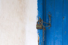 Blue door on white wall Stock Photo