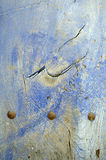 Blue Door. Detail of an old blue door with three bolts Royalty Free Stock Photo