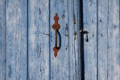 Blue door with doorhandle, Germany Royalty Free Stock Photography
