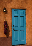 Blue door. With dried peppers hanging Royalty Free Stock Photography