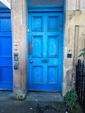 Blue door Edinburgh peeling paint stock photography