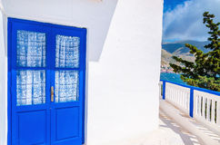Blue door in front of Greek house, Greece Royalty Free Stock Image