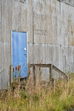 Blue door with graffiti on abandoned warehouse Royalty Free Stock Photography