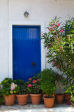 Blue door in greece Stock Images
