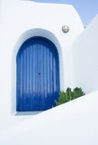 Blue door in a greek house Stock Photos