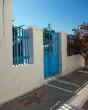 Blue door in a Greek island Royalty Free Stock Photos