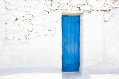 Blue door in a greek island of Mykonos Royalty Free Stock Images