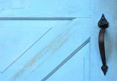 Blue Door with Handle. Detail of wooden blue door with black metal handle royalty free stock photography